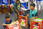 """<p>The Jesuit basketball team """"adopts"""" a local migrant family each year, providing Christmas gifts to the children. </p>"""