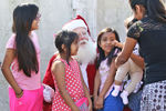 <p>The Jesuit service club Agmen Christi connected with migrant families in East Hillsborough County again this year to provide gifts for the children.</p>